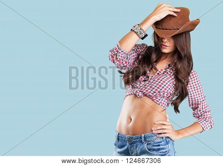 Portrait of a beautiful woman wearing  cowboy's hat
