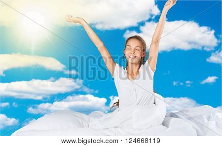 Young woman wakeup after sleeping on the white linen in bed at home