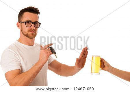 Man refusing alcohol beer showing car key as gesture of don't drink and drive isolated over white.