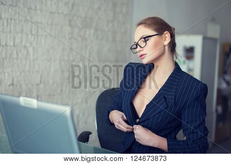 Sexy secretary in glasses undress in office online flirt and desire