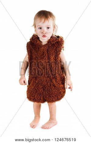 Little funny Neanderthal boy in a suit with a grubby face. Humorous concept ancient caveman