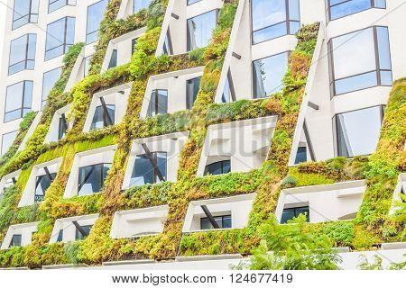 West Sunset Boulevard,Los Angeles, California 01.16.2016: IAC Brings California native plants grace the scuptural facade of 8800 West Sunset Boulevard in West Hollywood