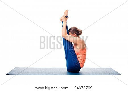 Woman doing Ashtanga Vinyasa yoga asana Urdhva mukha paschimottanasana - upward facing intense west stretch isolated on white