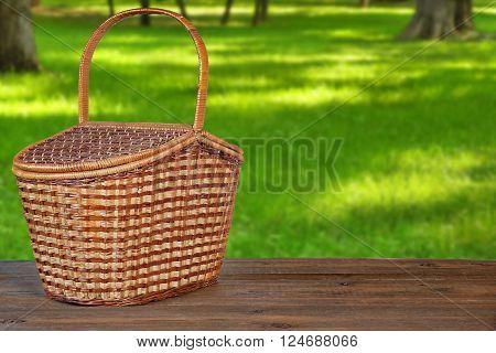 Picnic Basket Or Hamper On  Wooden Bench In Park