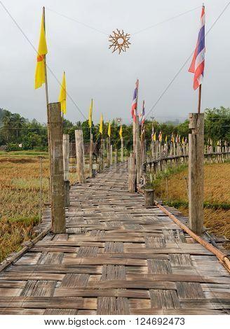 Bamboo bridge pass rice field in Thailand