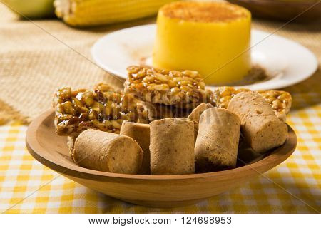 Typical Brazilian junina party sweets. Yellow background.