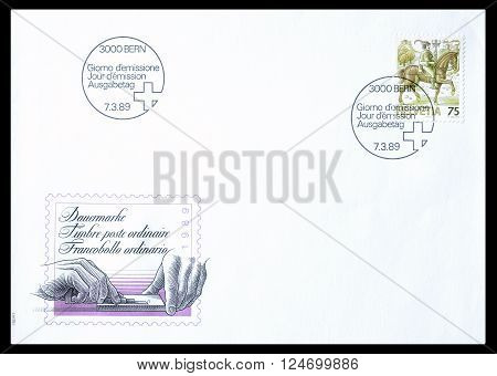 SWITZERLAND - CIRCA 1989 : Cancelled First Day Cover letter printed by Switzerland, that shows Adjustment table showing Dispatch rider.