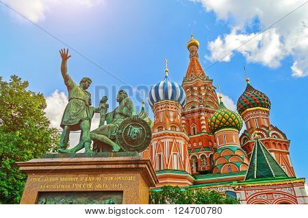 The monument to Minin and Pozharsky on the background of St. Basil's Cathedral at the Red Square in Moscow Russia. Architectural landscape