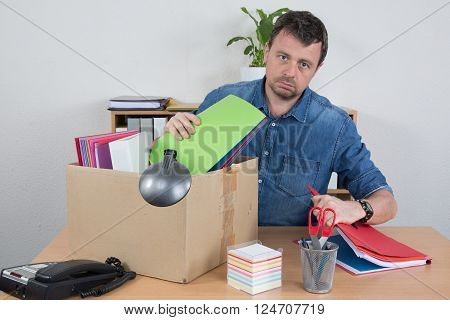 Redundant Business man With Possessions In Box