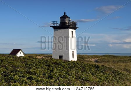 Wood End Lighthouse is located at the end of Cape Cod in Provincetown Massachusetts. The beacon is a popular hike for summer tourists.