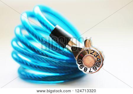 Blue lock for bike or luggage close up macro photo