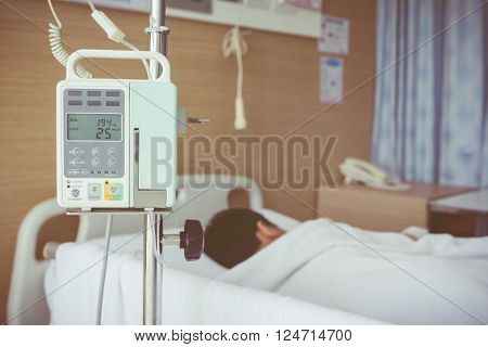 Asian Boy Lying On Sickbed With Infusion Pump Intravenous Iv Drip. Vintage Style.