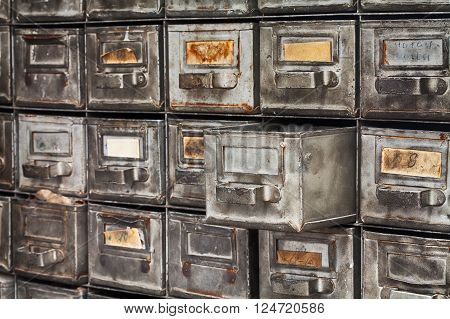 Opened archive file box, filing system. Rare metal boxes textured used shabby silver surface. library service, file cabinet interior concept.