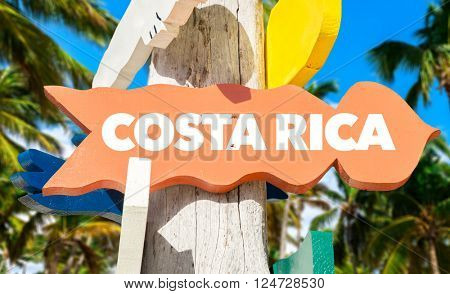Costa Rica signpost with palm trees
