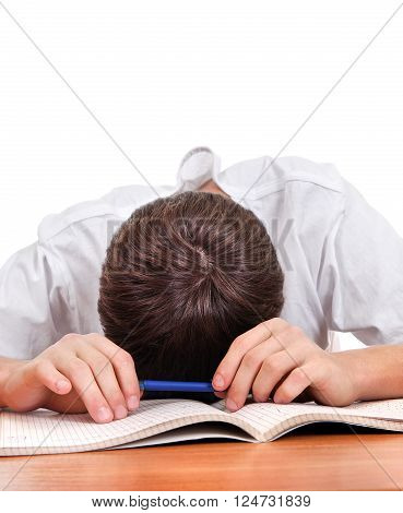 Tired Student sleep on the School Desk on the White Background