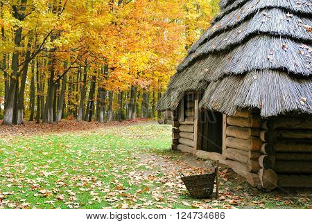 Ukrainian Museum Of Life And Architecture. Ancient Hut With A Straw Roof