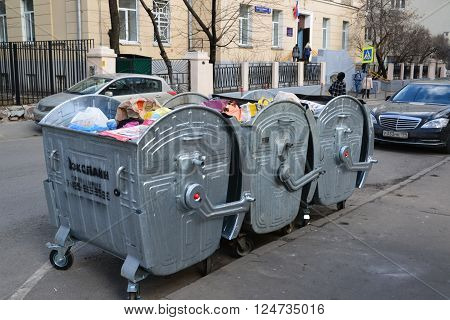 Moscow, Russia - March 14, 2016.  Three dumpsters on the street