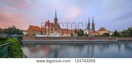 View on Church of the Holy Cross and St. Bartholomew, Cathedral Odra river and Tumski Island, Wroclaw, Poland