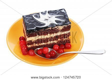 Chocolate cake with cranberries on orange plate isolated on a white background