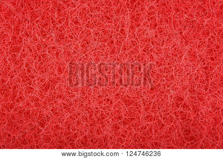 Highly detailed texture of red fabric for use as background
