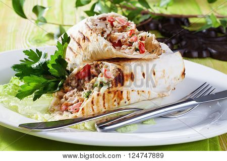 shawarma in thin pita bread on a plate small still-life green board restaurant beauty appetizing atmosphere, parsley, lettuce, freshness, grill