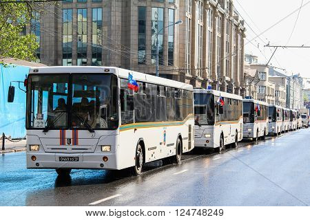 MOSCOW, RUSSIA - MAY 6, 2012: Line of the Emercom buses NefAZ 5299 in the city street.