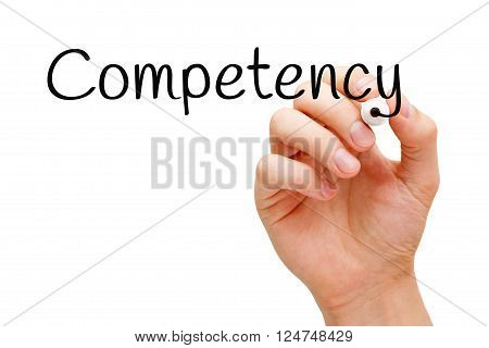 Hand writing Competency with black marker on transparent wipe board.