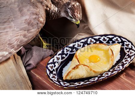 khachapuri  ajarian meal oriental plate with egg on a white background top menu Uzbek dishes stuffed eagle, taxidermy,