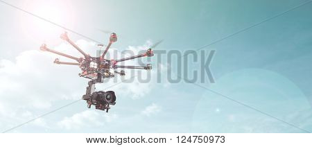 Proffeseonalny oktokopter with suspension and dslr camera. Copter is designed for video and photo shooting. Drone on the radio at a frequency of 2.4 Hz. The heavy drone of eight rays. poster