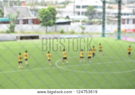 blurred Players in action playing football speed yoyo test (soccer)