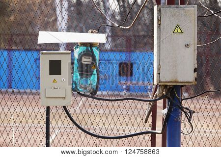 the electric meter and a junction box