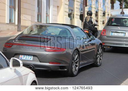 Monte-Carlo Monaco - April 6 2016: Porsche 911 Targa 4S on Avenue d'Ostende in Monaco. Man Driving an Expensive Gray Porsche 911 Targa 4S in the south of France