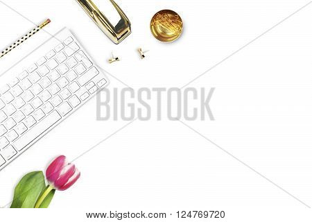Office desk and woman objects on white table. Flat lay. Tulip gold stapler pencil. Table view. Still life of fashion