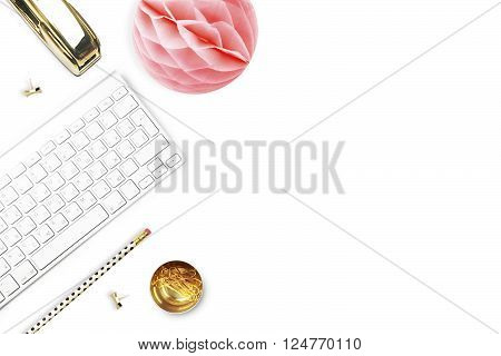 Office desk and woman objects on white table. Flat lay. Paper ball gold stapler pencil. Still life of fashion.