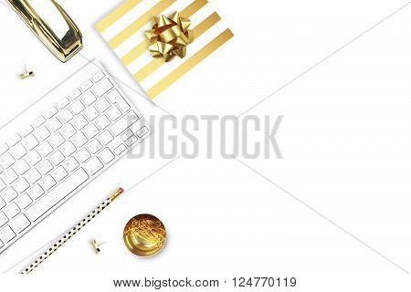 Flat lay office white desk and keyboard with gold stationery. Gold stapler stripe gold pattern pencil. View top. Table up. Mock-up background