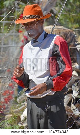 KAOKOLAND NAMIBIA OCTOBER 14 2014: Unidentified old man in the side of the road. In Namiba the proportion of  old people is 3.7% was 65 years or older
