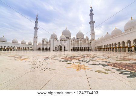 ABU DHABI, UAE -26 MARCH 2014: Sheikh Zayed Grand Mosque in Abu Dhabi, United Arab Emirates. Grand Mosque in Abu Dhabi is the largest mosque in United Arab Emirates for more than 40,000 prayers.