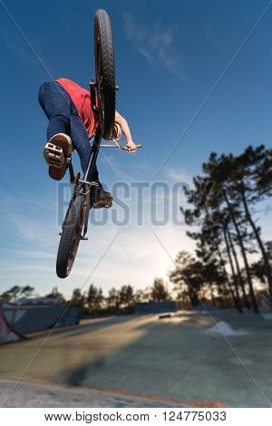 Stunning High BMX jump in a skate park.