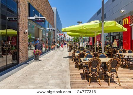 ASHDOD, ISRAEL - JULY 24, 2015: Shops and boutiques in open mall - owned by BIG Shopping Centers Ltd., founded in 1994 and operates in four countries - Israel, the United States, India and Serbia.