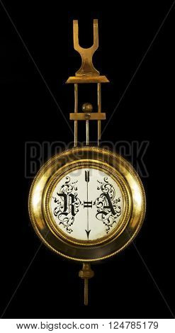 the pendulum wall clock. The end of the 19th century. Isolated on a black background