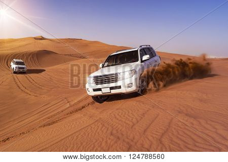 Desert Safari SUVs bashing through the arabian sand dunes