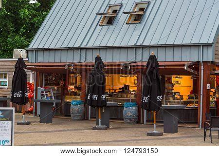 RENESSE ZEELAND THE NETHERLANDS - JUNE 14 2015: Renesse city center on the main street overlooking a restaurant.