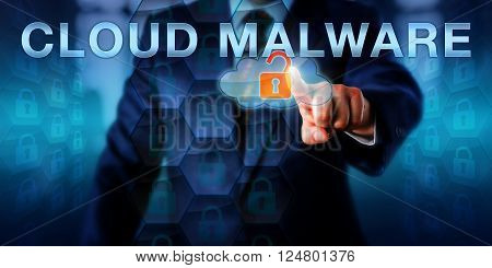 Enterprise executive is pointing at CLOUD MALWARE on a virtual touch screen interface. Information technology and computer security concept for malicious software attacks targeting the cloud.
