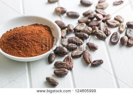 cocoa powder and beans on kitchen table