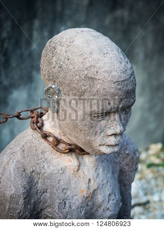 Sculpture of slaves dedicated to victims of slavery in Stone Town of Zanzibar placed close to the former slave market.