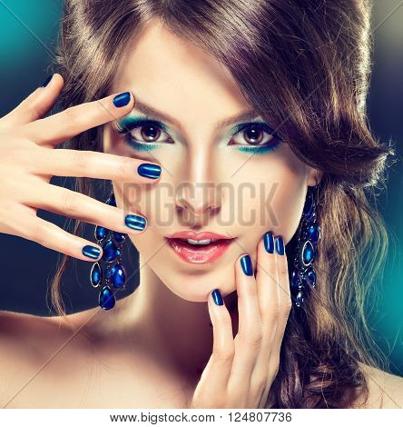Model girl with blue makeup and manicure nail . Cosmetics , beauty makeup and cosmetology . poster