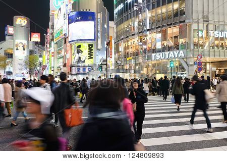 Tokyo, Japan - March 29, 2016: Shibuya Crossing at Night, Crowds of people at Shibuya Crossing on 29 March 2016 in Tokyo, Japan. Shibuya Crossing is one of the busiest crosswalks in the world.