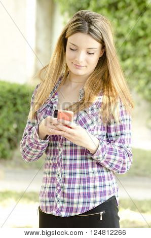 beautiful girl using a smartphone for social networking