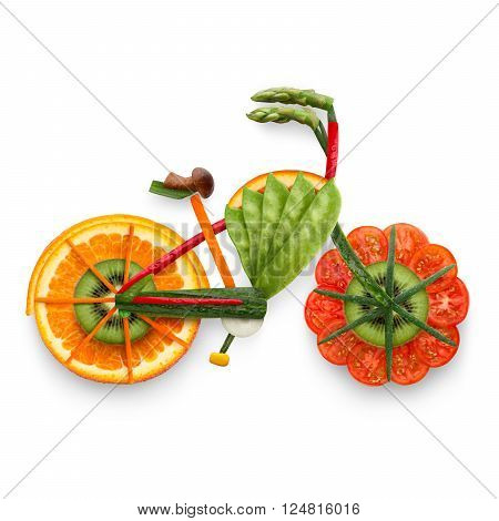 Healthy food concept of an electric bicycle in detail made of fresh vegetables and fruits full of vitamins isolated on white.
