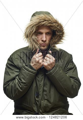 High key studio portrait of young adult caucasian model wearing winter coat with hood.
